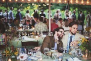 Guests dining under a tent