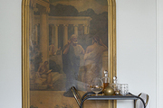 Part of a classical era–themed diptych behind a bar cart