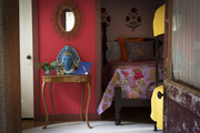 Brightly colored bedroom with eclectic details