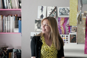 Designer Kit Kemp in front of a mood board in her work space