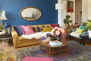 A living space with bold colored furniture and accent pillows.