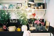 Open shelves above a skirted sink in a potting room