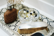 A snakeskin-print tray topped with bathroom accessories