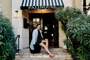 Camilla Belle under a black and white awning at Palihouse Santa Monica