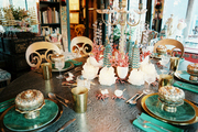 A dining table decorated with snakeskin and malachite patterns