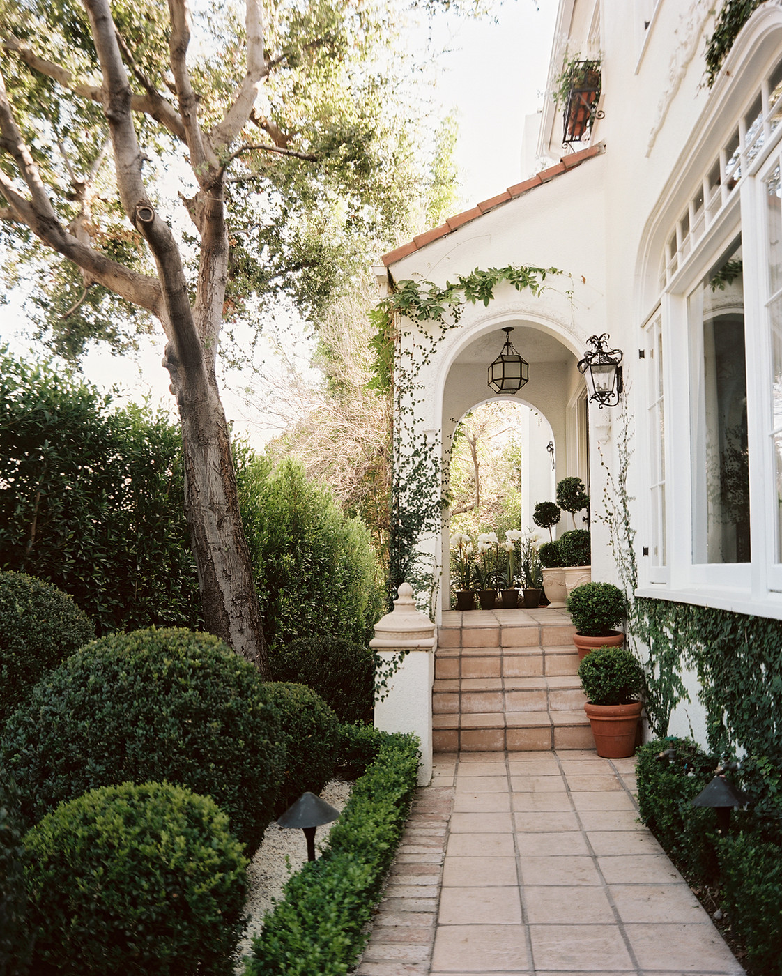 Mediterranean Exterior Of Home With Pathway Fountain: Front Stoop Photos, Design, Ideas, Remodel, And Decor