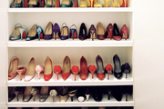 Shoes on display on white shelving
