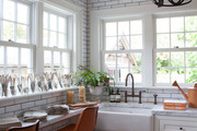 A kitchens space with subway tile and a farmhouse sink