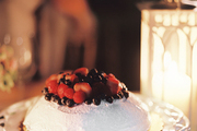 Berry pavlova at an outdoor dinner party