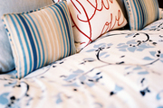 A mix of patterns outfitting a bed
