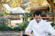 A chef inspects an organic garden at the Golden Door Spa