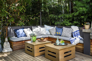 An upholstered banquette with Ikat pillows in textile designer Bridgid Coulter's backyard