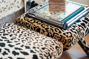 A pair of leopard-print benches