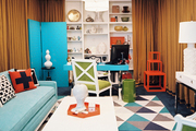 A geometric rug and a blue couch in an office space