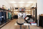 Surfboards and apparel on display in a retail environment