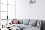 A contemporary sectional and floor lamp on limed oak floors