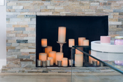 A stone fireplace with faux candles.