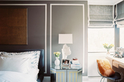 Gray walls with white trompe-l'oeil picture molding