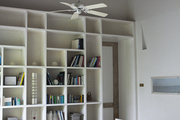 A covered patio with built-in bookshelves.