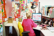 A Lilly Pulitzer employee at work in front of a colorful inspiration board