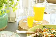A tablescape of organic Urban Remedy juices and snacks in Malibu, California