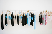 Wall mounted clothing rack displaying children's beach wear.