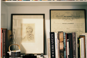 Bookshelf styling with framed art and decorative accessories