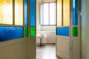Colored glass panels in a bathroom entryway