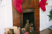 A fireplace decorated for the holidays.