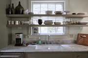 A traditional kitchen with open shelving.