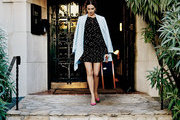 Camilla Belle under a striped awning at Palihouse Santa Monica