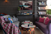 Cozy sofas with colorful pillows and throws
