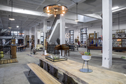A long dining table and bench at Amuneal's American Street Showroom