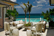 An outdoor terrace overlooking the Caribbean Sea