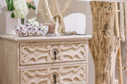 A shabby chic chest adorned with decorative objects.