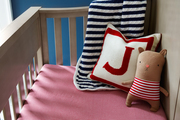 Striped bedding in a child's crib.