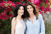 Neka Pasquale and Cindy Crawford beneath a bright pink bougainvillea tree in Malibu, California