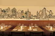 A mural above a banquette in a dining space