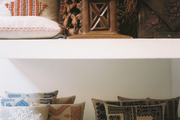 Pillows and home accessories arranged on shelves