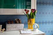 Colorful tulips pop against a moody wallpaper