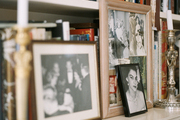 White built-in shelves filled with books, framed photos, and candlesticks