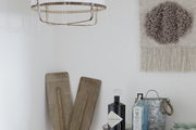 A bar area with rustic accents and a woven wall hanging.
