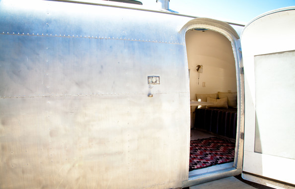 April 2013 Issue - A geometric rug in the entrance to a vintage Airstream