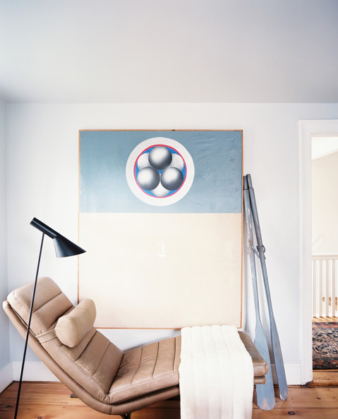 Ari Heckman - A chaise paired with a midcentury task lamp and large-scale artwork