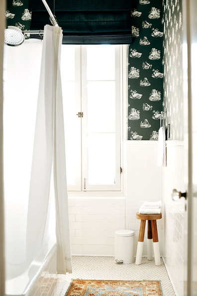 Asian - A wallpapered bathroom with subway tile