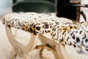 A pair of benches covered in leopard print