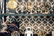 Trophy cups and plaid blankets on industrial shelving