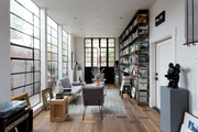 A spacious Venice Beach living room with a library.