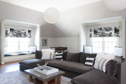 Grey and white couches in spacey living room.