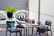 An outdoor seating area and dining table